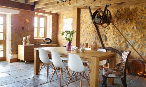 Creative spaces: the mill's original wheel workings behind the dining table.