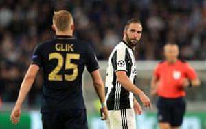 Higuain stares back at Kamil Glik.