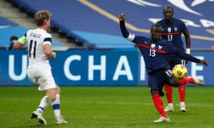 France's N'golo Kante (right) shoots past  Finland's Rasmus Schueller.