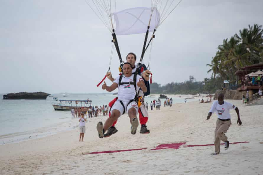 Kenya's tourism minister, Najib Balala, comes in to land after skydiving in the coastal town of Watamu in a stunt to attract foreign visitors