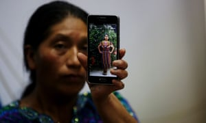 Dominga Vicente, a relative of Claudia Patricia Gómez Gonzáles, shows a photo of her during a press conference in Guatemala City on 25 May.