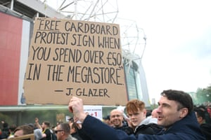 A protester with a light-hearted sign outside the ground.