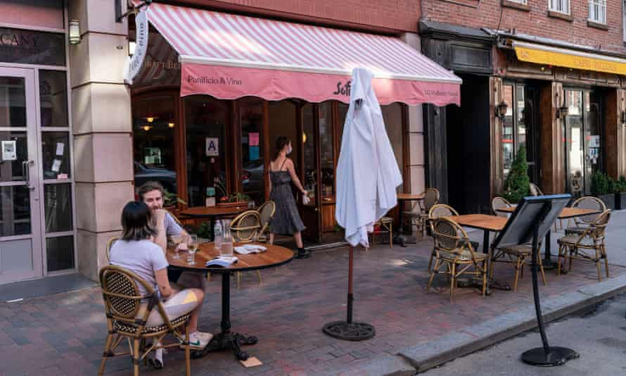 Restaurants in Little Italy serve customers outdoors in New York, New York, on 21 June.