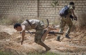Fighters loyal to the UN-backed Libyan government run for cover during clashes with forces loyal to strongman Khalifa Haftar in the suburb of Ain Zara, south of the capital Tripoli.