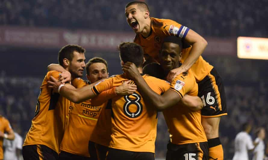 The Wolves captain Conor Coady, top, joins the celebration following Romain Saïss's opening goal against Fulham.