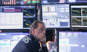 A trader at the New York Stock Exchange on Wednesday, as the Dow fell 800 points.