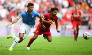 Rodri battles for the ball with Liverpool's Mo Salah. The Spaniard looked a reassuring presence in midfield for the reigning champions.