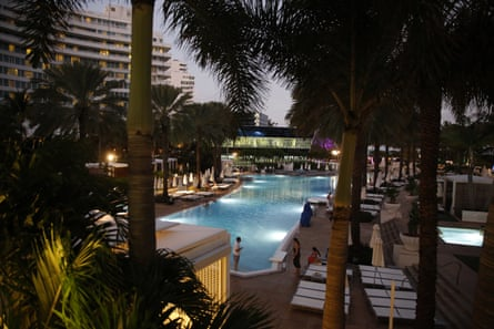 Tourists visit the pool outside of the Fontainebleau Miami Beach hotel.
