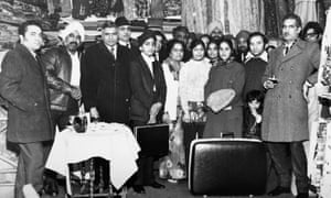 28 Southall Punjabis at the opening of one of one of its first textile stores circa 1970