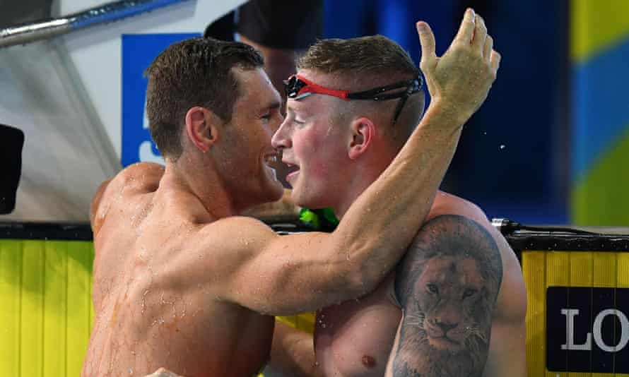 England's Adam Peaty (right) congratulates Cameron van der Burgh after the South African won the 50m breaststroke at the Commonwealth Games