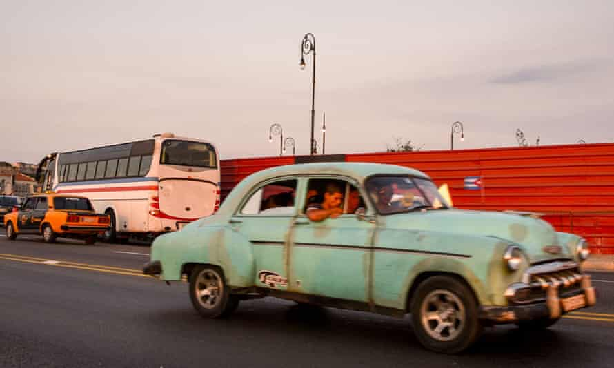 Sharing a almendrón (collective taxi) in Cuba is a cheap and fun way of riding in a classic old American car.