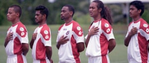 Jaiyah Saelua (second right) sings the national anthem before playing for the American S?moa football team Stills taken from 'Next Goal Wins'.