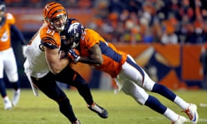 C.J. Uzomah, Bradley Roby<br>Cincinnati Bengals tight end C.J. Uzomah (87) is hit by Denver Broncos free safety Bradley Roby (29) during the first half of an NFL football game, Monday, Dec. 28, 2015, in Denver. (AP Photo/Jack Dempsey)