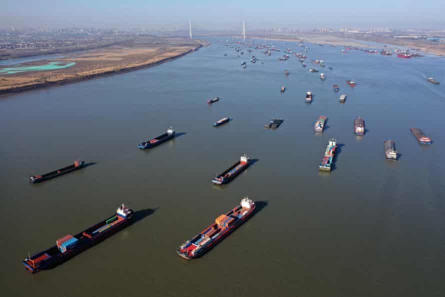 Aerial view of cargo ships sailing along Yangtze River in Wuhan, Hubei Province of China.
