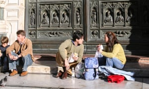 Tourists eating in front of the cathedral in Florence.