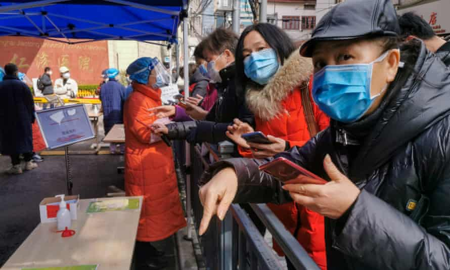 Residents wait to be seen at a hospital in Shanghai.