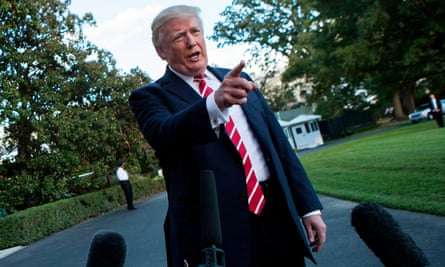 US President Donald Trump speaks with reporters outside the White House prior to his departure aboard Marine One on October 7, 2017.