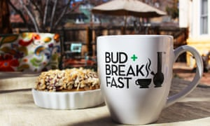 Mug of coffee, on an outdoor table, with the logo 'Bud and Breakfast' – at the cannabis-friendly Adagio Bud + Breakfast hotel in Denver, Colorado, US