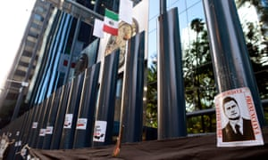 Stickers with the image of the Mexican president, Enrique Peña Nieto, are stuck on columns outside the building of the attorney general's office during a protest against alleged government spying.