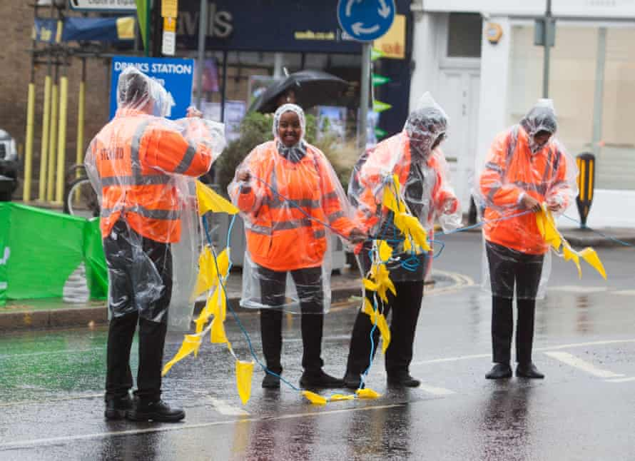 Race stewards at the Prudential RideLondon-Surrey 100 cycling event.
