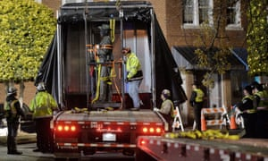 Workers load a Confederate statue on to a truck after it was removed from its spot in front of the historic Chatham county courthouse in Pittsboro, North Carolina, early on Wednesday.