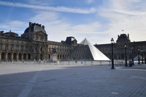 Paris, France View of the empty space outside the Louvre pyramid and the Louvre museum. French Prime Minister Edward Philippe announced that France will shut shops, restaurants and entertainment facilities from midnight to slow down the spread of the coronavirus.