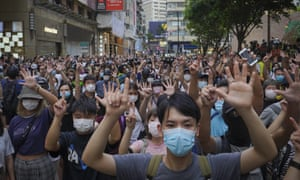 """protesters against the new national security law gesture with five fingers, signifying the """"Five demands - not one less"""" on the anniversary of Hong Kong's handover to China"""