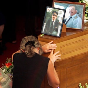 The first officer's wife at his funeral three days after the crash.