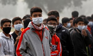 People wear masks in Delhi to combat high pollution  levels
