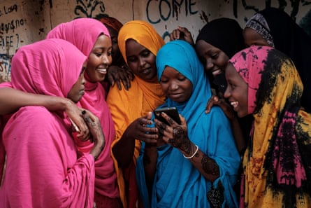 Somali women using a smartphone