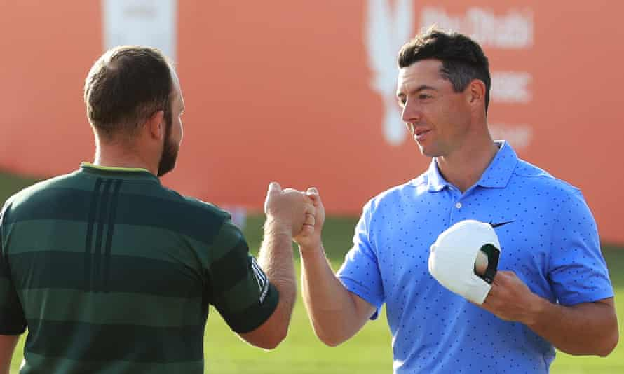 Tyrrell Hatton and Rory McIlroy bump fists on the 18th green after the Englishman's win at the Abu Dhabi Championship.