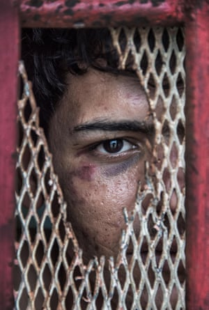 NIKON-WALKLEY PORTRAIT PRIZE WINNERBy Brian CasseyIraqi asylum seeker Abdullatif Almoftaji stares through the wire of a police cell in the town of Lorengau, Manus Island in Papua New Guinea. Abdullatif was 17-years-old when he was first detained trying to enter Australia three years ago. He is pictured here in jail, having been arrested for allegedly trying to steal food while drunk, among other things. Cassey made the image through a hole in the cell wire. Later police caught Cassey trying to pass Abdullatif food and clothes and threatened to lock him up too.