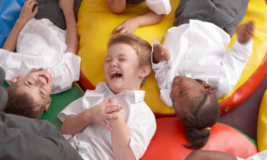 Children at school laughing