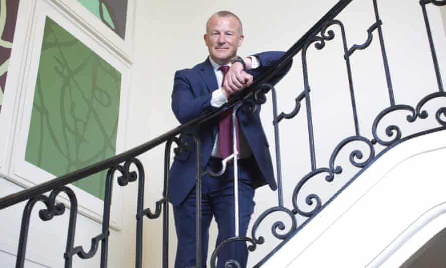 Neil Woodford pictured on a winding staircase