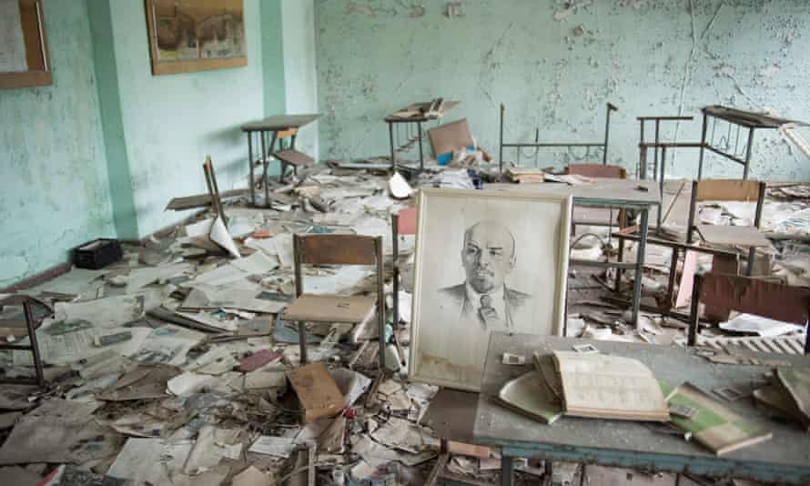 ChernobylUkraine, Pripyat, February 4, 2016 A portrait of Lenin stands on a chair in a classroom of School number 3 in Pripyat. The town was build in the 1970s to accommodate the Chernobyl power plant workers and their families. 30 Years ago, a day after the explosion of reactor number 4 on April 26, 1986 the 50,000 people living in Pripyat were evacuated. Photo: Joel van Houdt for The Guardian