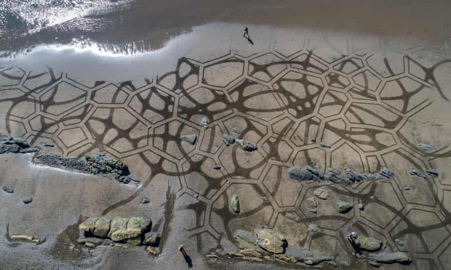 Andres Amador makes large-scale, impermanent artworks on the beach in California.