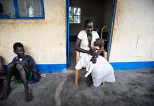 Apath Majon with her 17-month-old daughter Cholok at Abiriu health centre.