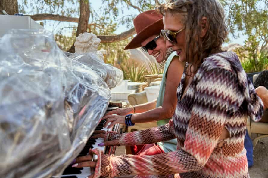 Stephanie and Carey Ann play a piano together.