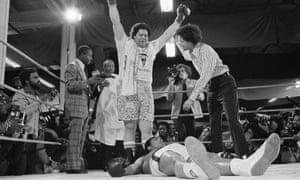 Muhammad Ali lies on the canvas after his second knockdown in first round of fight on Tuesday, Jan. 21, 1975 with Atlanta Mayor Maynard Jackson.