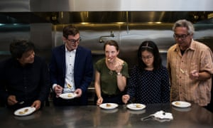 Taste of the future ... the panel (from left) – Ron Shigeta of Indie Bio, Brian Wyrwas, Amy Fleming, and Finless Foods' Jihyun Kim and Robert Hughes – try the cultured carp croquettes.