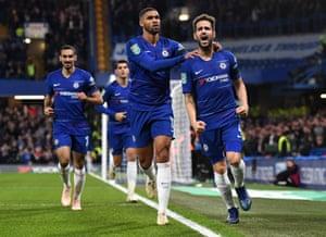 Cesc Fabregas of Chelsea celebrates with teammate Ruben Loftus-Cheek after scoring his team's third goal.