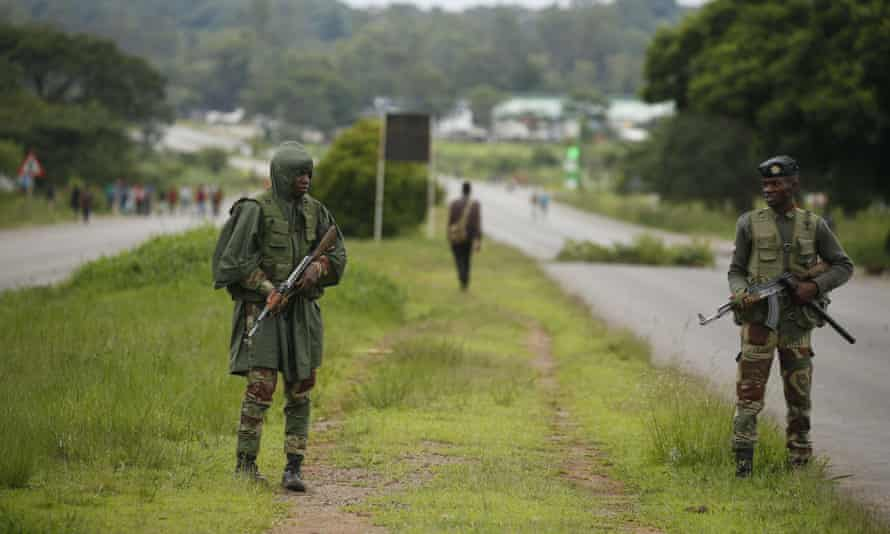 Soldiers patrol a highway in Harare
