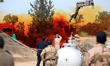 Experts in Tripoli monitor a November 2012 operation to dispose of Libyan chemical weapons.