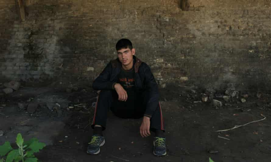 Farridulah, a 16-year-old Afghan, at the abandoned brick factory in Subotica. Varga described it as his 'church'.