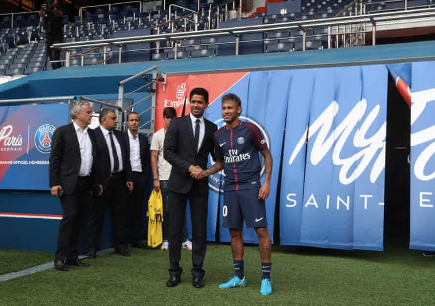 Neymar poses with president Nasser Al-Khelaifi during his presentation to the press at Parc des Princes in 2017.
