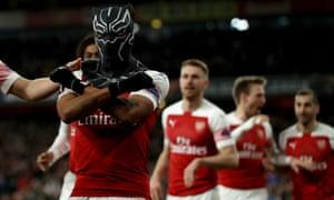 Arsenal's Pierre-Emerick Aubameyang celebrates scoring their third goal wearing a Black Panther mask.