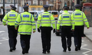 Police walking down the street in Streatham.