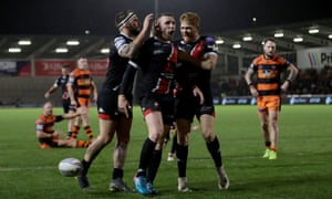 Jackson Hastings celebrates with his Salford teammates after scoring against Castleford.