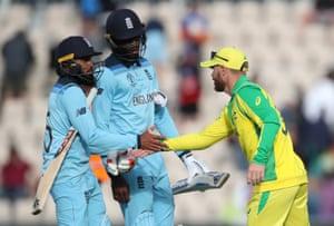 Australia's David Warner shakes hands with England's Adil Rashid and Jofra Archer