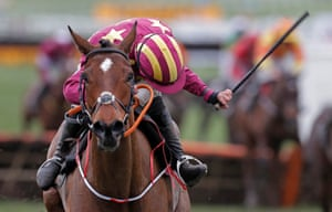 Rachael Blackmore on board Minella Indo gives her horse a whip as she wins the Albert Bartlett Novices Hurdle